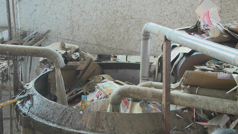 Cardboard boxes are washed in a crude washing machine Footage