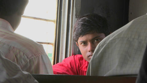 A young man rides on a train in India Footage