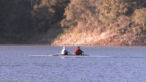 Panning two people rowing a double scull on Lake Casitas in Oak View, California Footage