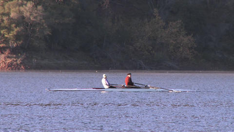 Panning two people rowing a double scull on Lake Casitas... Stock Video Footage