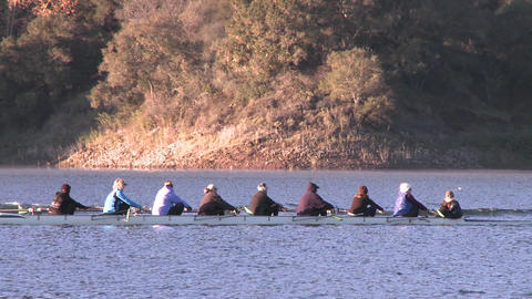 Panning of an eight person rowing sweep on Lake Casitas in Oak View, California Live Action