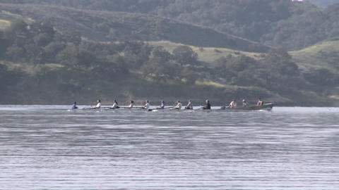 Panning an eight person rowing sweep being followed by... Stock Video Footage