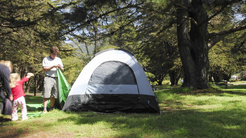 Time lapse of a person setting up a tent at Plaskett Creek Campground in Big Sur, California Footage