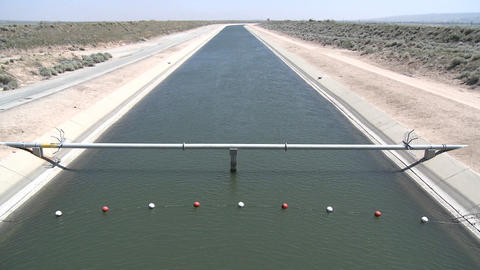 Tilt up of state water in the California Aqueduct near Lancaster, California Footage