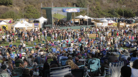 Time lapse of a crowd at an outdoor concert in Ventura, California Footage