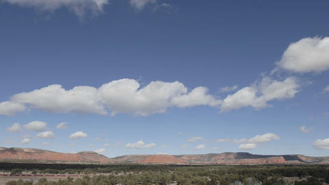 Time lapse of winter clouds in a blue sky over the... Stock Video Footage