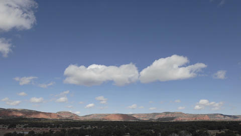 Time lapse of winter clouds in a blue sky over the Continental Divide in New Mexico Footage