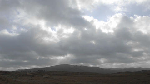 Time lapse of clouds and sunflares over peat bogs at Croagleheen, Ireland Footage