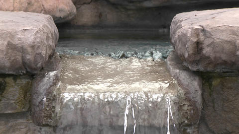 Tilt down of water in a fountain in Oak View, California Stock Video Footage