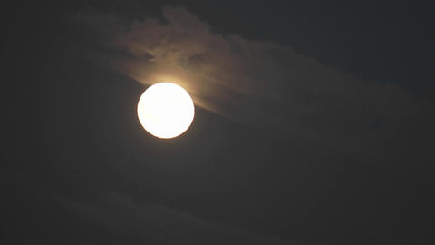 Time lapse of full moon rising out of the clouds in Oak View, California Footage