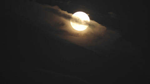 Time lapse of full moon rising out of the clouds in Oak... Stock Video Footage