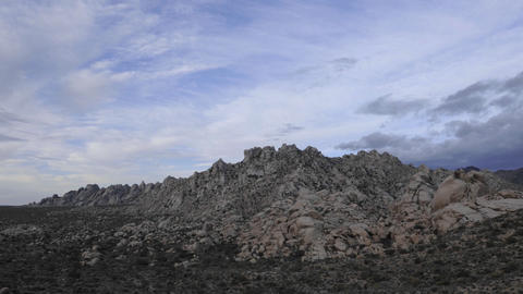 Time lapse of storm clouds over the Granite Mountains in... Stock Video Footage
