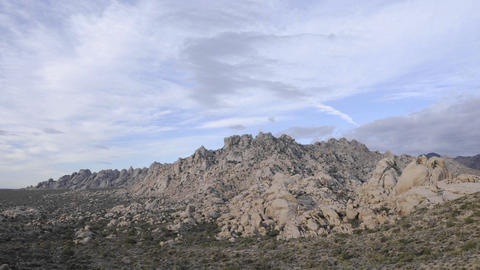 Time lapse of storm clouds over the Granite Mountains in Mojave National Preserve, California Footage