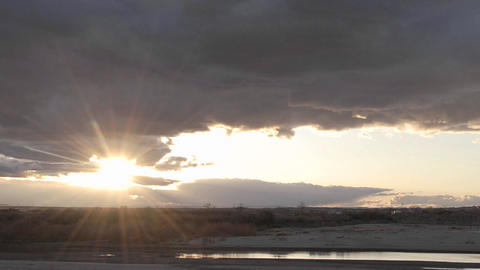 Zoom out time lapse of clouds and sunset at Homolovi... Stock Video Footage