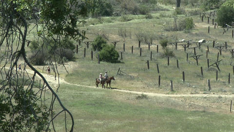 Two hikers and horse riders on a trail on the Ventura... Stock Video Footage