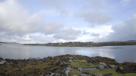 Panning time lapse of clouds blowing over the water at Doe Castle near Creeslough in County Donegal Footage