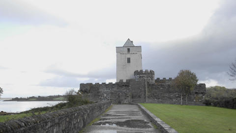 Time lapse of clouds blowing over Doe Castle near... Stock Video Footage