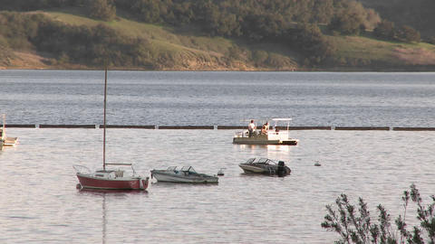 Boat leaving the harbor on Lake Casitas Recreation Area... Stock Video Footage