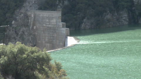 Above side view of water spilling over the Matilija Dam... Stock Video Footage