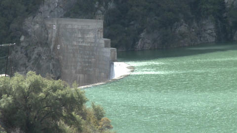 Above side view of water spilling over the Matilija Dam in Ojai, California Footage