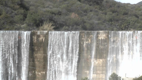 Zoom out of water spilling over the Matilija Dam after a... Stock Video Footage