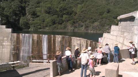 Side view of water spilling over the Matilija Dam during a guided tour in Ojai, California Footage