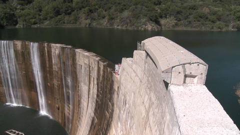 Pan side view of water spilling over the Matilija Dam in... Stock Video Footage