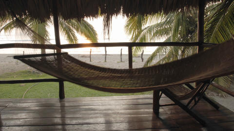 Time lapse of man sitting in a hammock in palapa at La... Stock Video Footage