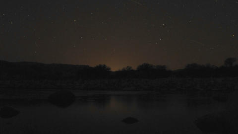 Time lapse of cresent moon and stars setting over the Ventura River in Oak View, California Footage