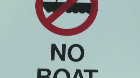 Tilt down on No Boat Entry sign due to quagga mussel quarantine at Lake Casitas Recreation Area in O Live Action