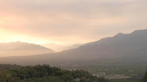 Wide time lapse of a smokey sunset from wildfires in... Stock Video Footage