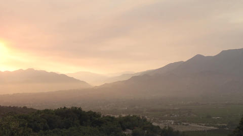 Wide time lapse of a smokey sunset from wildfires in Ojai, California Footage