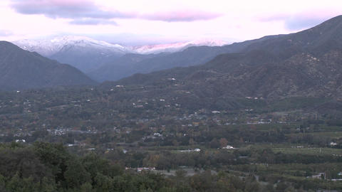 Slow pan of sunrise on the snow-covered Santa Ynez... Stock Video Footage