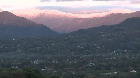 Wide zoom out of sunrise on the snow-covered Santa Ynez... Stock Video Footage