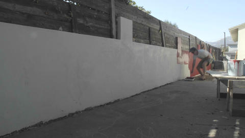 Time lapse of a man painting a wall in Oak View, California Footage