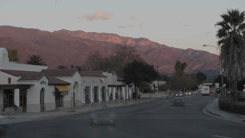 Time lapse of sunset on the Topa Topa Mountains and cars in downtown Ojai, California Footage