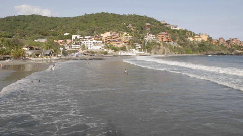 Time lapse of people swimming at Playa de Madera in... Stock Video Footage