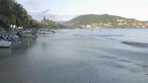 Time lapse of fishing boats launching from Playa... Stock Video Footage