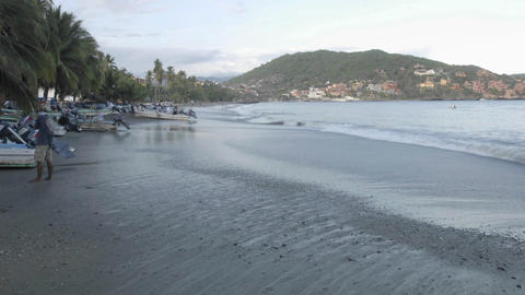 Time lapse of fishing boats launching from Playa Principal in Zihuatanejo, Mexico Footage