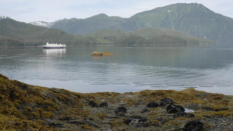 Time lapse of incoming tide, kayakers and ship anchored at Pond Island in Southeast, Alaska Footage