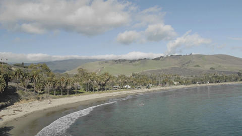 Panning time lapse of clouds passing over Refugio Beach... Stock Video Footage