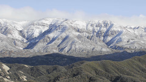 Time lapse of clouds passing over snowy Reyes Peak in the... Stock Video Footage