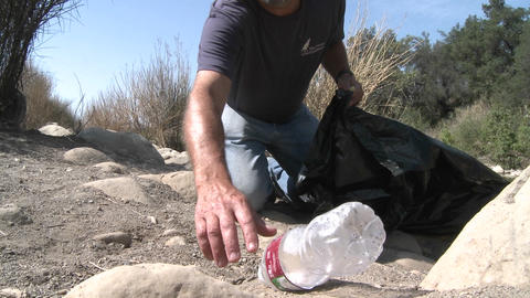 Man picking up trash on the Ventura River Preserve in... Stock Video Footage