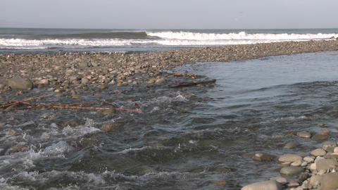 Water flowing out of the Ventura River estuary into the... Stock Video Footage