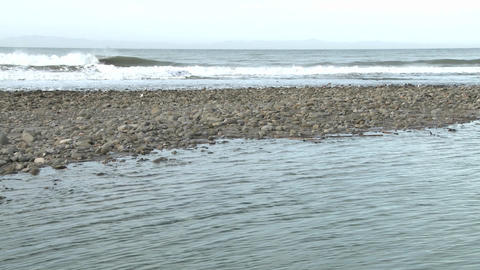 Tilt up of water flowing out of the Ventura River estuary... Stock Video Footage