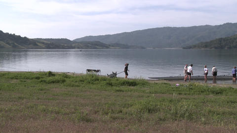 Time lapse of eight person rowing sweep leaving the water on Lake Casitas in Oak View, California Footage