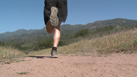 Low angle of man trail running on the Ventura River Preserve in Ojai, California Footage