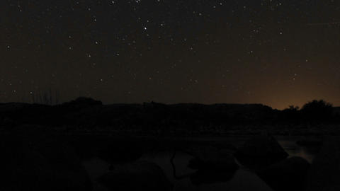 Time lapse of the moonrise and stars setting over the... Stock Video Footage