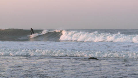 Surfer catching a wave at Surfers Point in Ventura,... Stock Video Footage