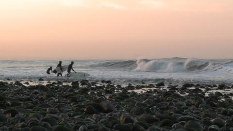 Surfers paddling out at into the waves at Surfers Point... Stock Video Footage